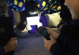 Children-from-Curie-class-carrying-out-an-investigation-about-reflective-materials