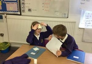 Zac and Scarlett testing each other on shape properties in Owens class